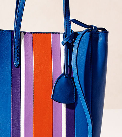 Bright blue tote with contrasting variegated stripes at center