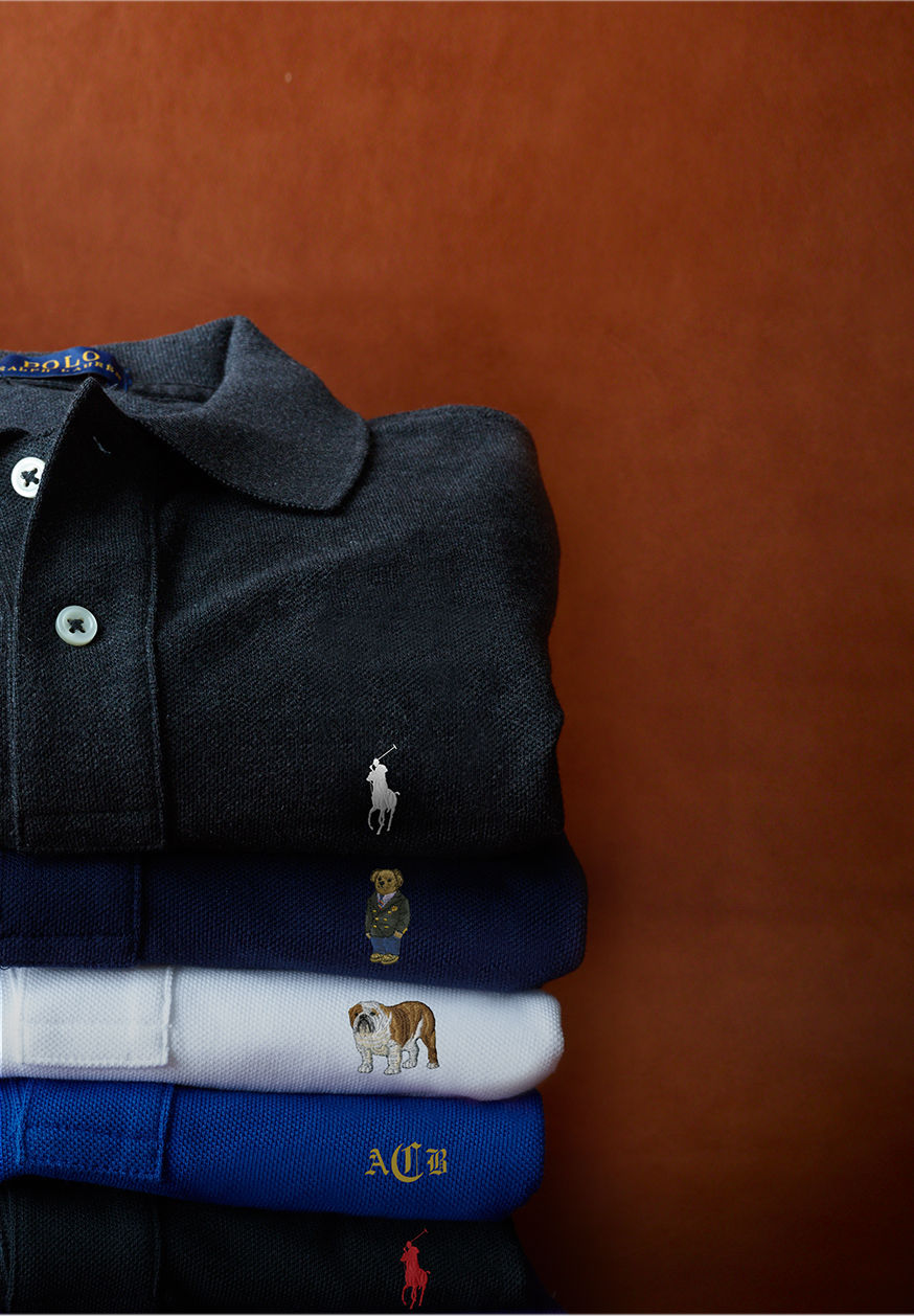 Folded Polo shirts, each with pony, Polo bear, dog, or monogram embroidery