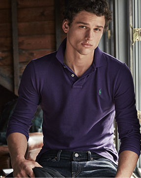 Man models purple long-sleeve Polo shirt with green signature embroidered pony