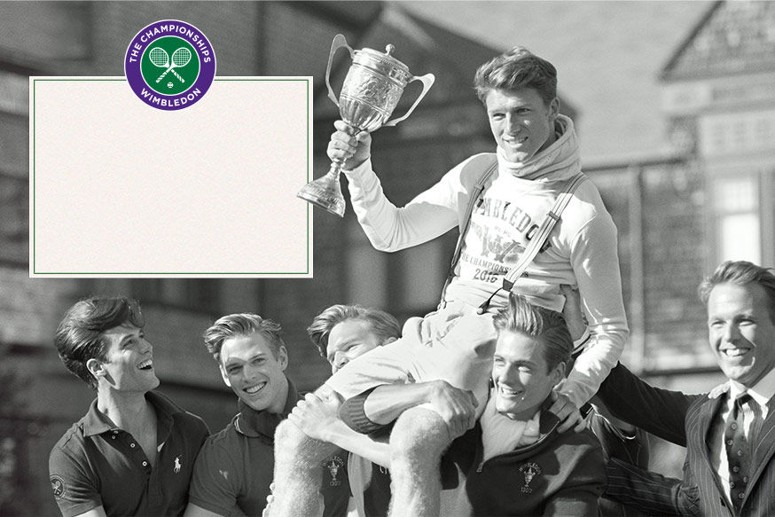 Man in sweatshirt and suspenders holds up trophy as several men carry him on their shoulders