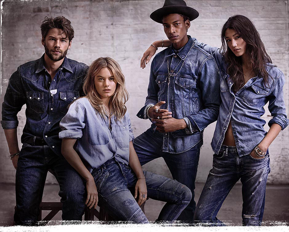 Men & women model chambray shirts & blue jeans
