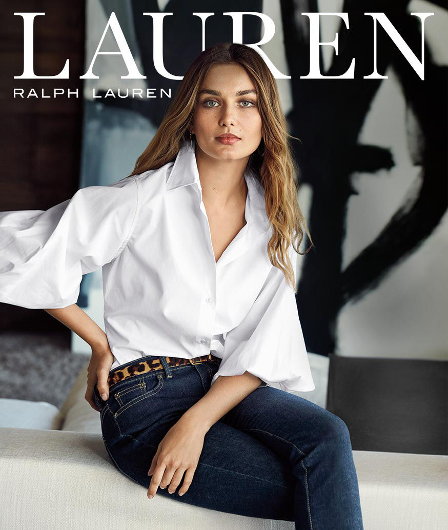 Lauren Ralph Lauren - Woman wears white blouse with billowy sleeves & animal-print belt