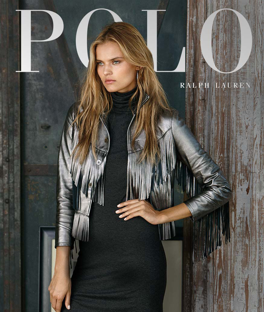 Woman layers silvery metallic fringed jacket over grey turtleneck dress