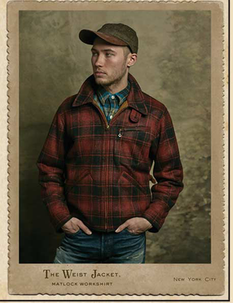 Man wears plaid Weist jacket with leather-brimmed cap & jeans