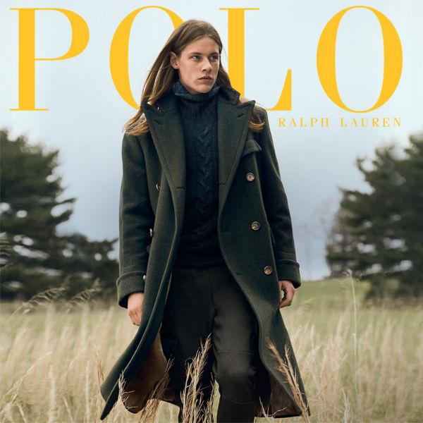 Polo Ralph Lauren Man layers long green coat over blue Aran-knit sweater