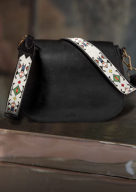 Black leather bag with contrasting beaded strap