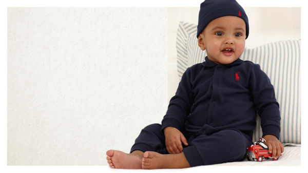Baby wears navy hat \u0026amp; coverall with matching red signature pony embroidery