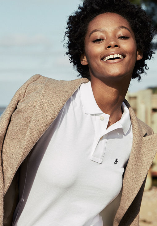 Woman pairs white Polo shirt with tweed blazer