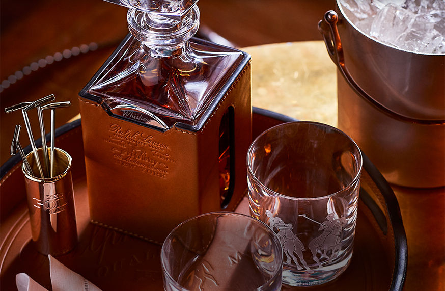 Leather-covered decanter shown with polo-themed tumblers & cocktail picks