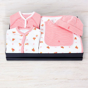 Boxed gift set featuring items with pink Polo Bear pattern and pink stripes.