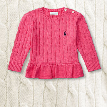 Pink cable-knit peplum sweater.