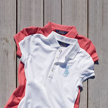 White Polo shirt stacked on top of salmon-colored Polo shirt.