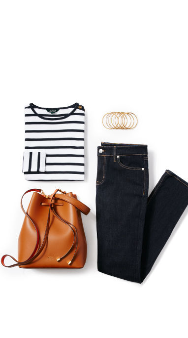 Folded striped shirt, dark jeans, gold-tone bangles & brown drawstring bag