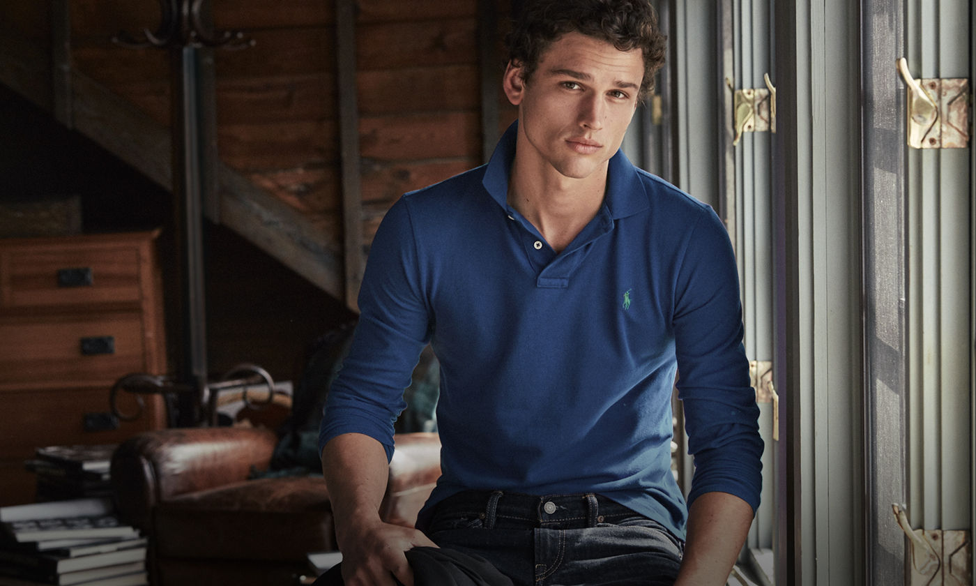 Man in long-sleeve blue Polo shirt accented with embroidered Polo Pony