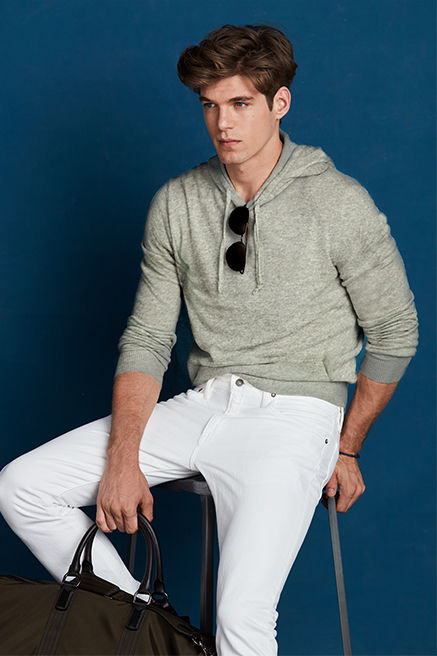 Man modeling light grey cashmere hoodie
