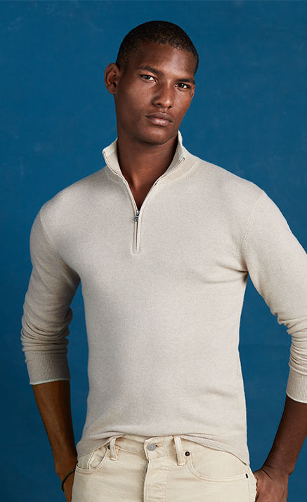 Man modeling cream cashmere half-zip sweater