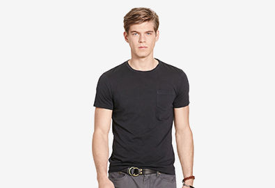 Man in black pocket T-shirt tucked into grey pants