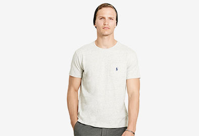 Man in white T-shirt with embroidered Polo Pony at chest pocket