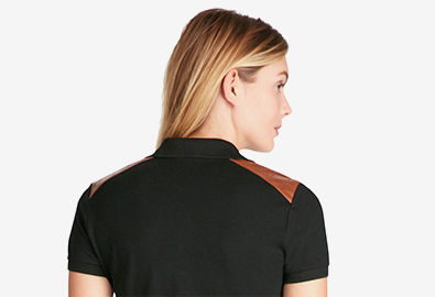 Woman in black slim Polo shirt with leather shoulder patches