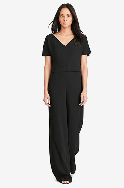 Woman in short-sleeve draper jumpsuit