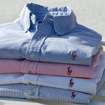 Neat stack of folded blue, pink & striped button-downs