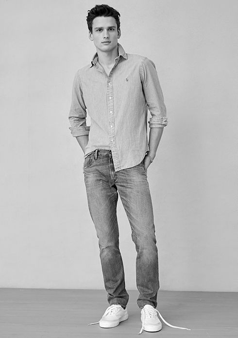 Man with hands in pockets of jeans, worn with untucked button-down