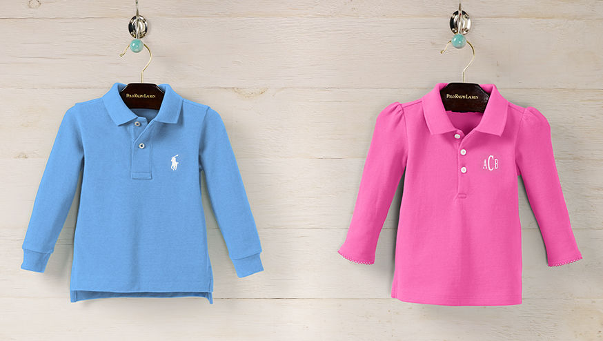 Personalized long-sleeve Polo shirts in blue and pink displayed on hangers.