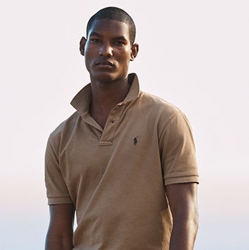 Man models tan Polo shirt with popped collar