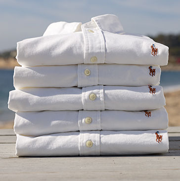 Neat stack of folded white button-downs with Polo Pony at chest