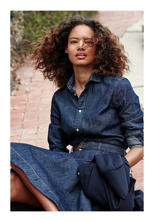 Woman models belted denim shirtdress