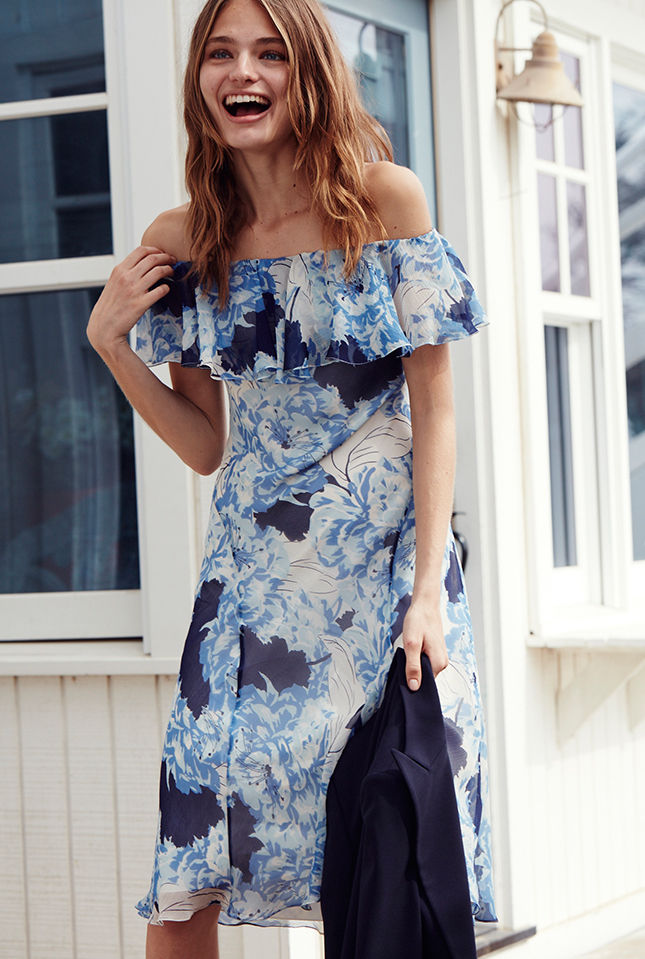 Woman in blue & white floral-print off-the-shoulder dress