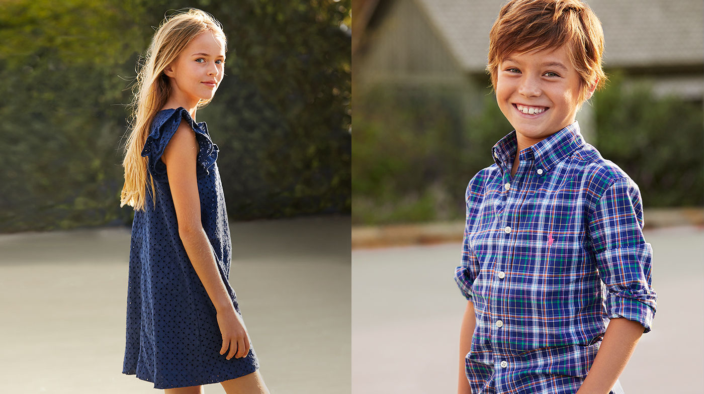 Girl in ruffle-sleeve dark blue shift dress, Boy in spring-hued plaid button-down