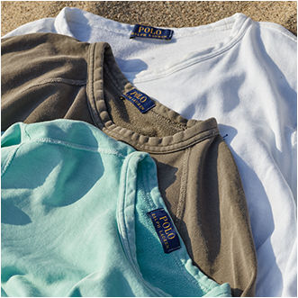 Stacked crewnecks in white, olive, and turquoise