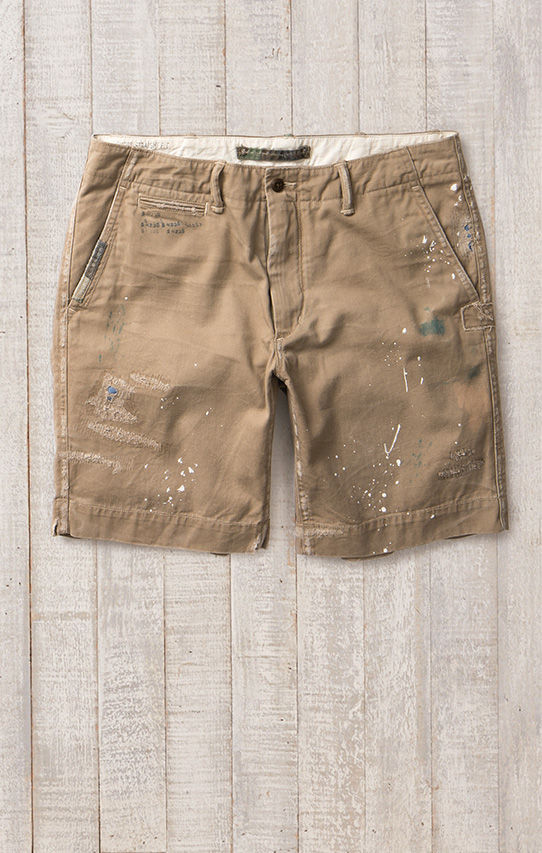 Khaki shorts with ripped-and-repaired details