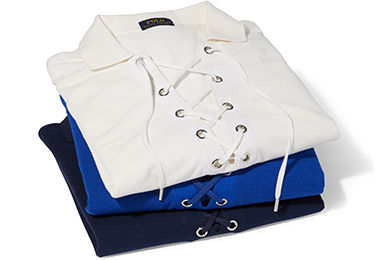 Stack of folded lace-up-placket Polo shirts