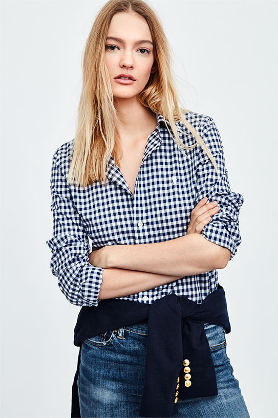 Woman models slim-fitting navy gingham checked button-down