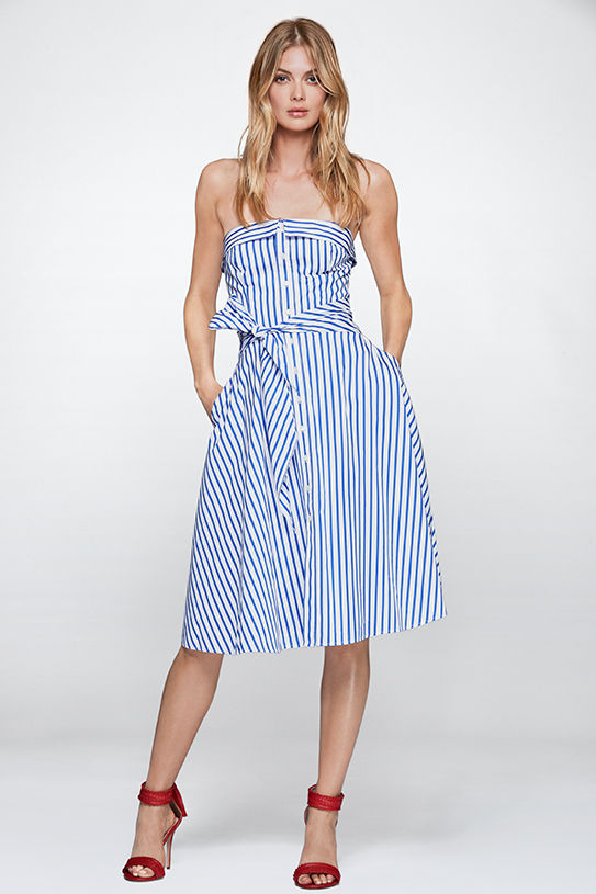 Woman models blue-and-white striped strapless dress