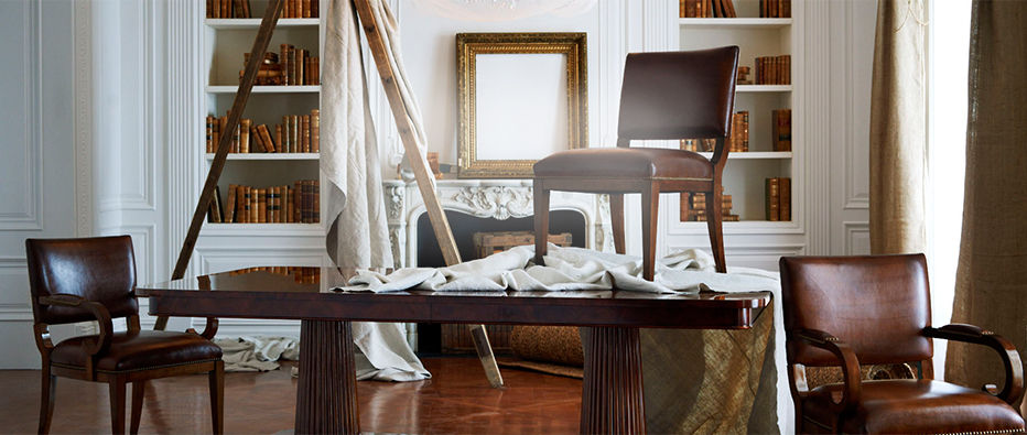 Dining room with leather chairs & ladder with drop cloths