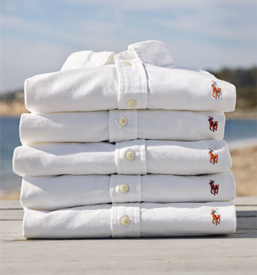 Stack of folded white button-down oxford shirts