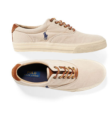 Pair of khaki cotton twill sneakers with Polo Pony at outer side