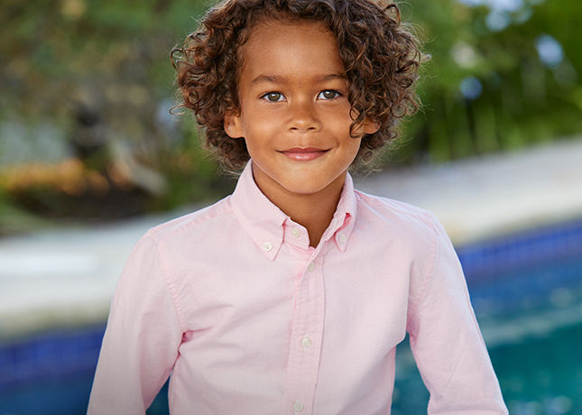 Boy in crisp light pink button-down shirt