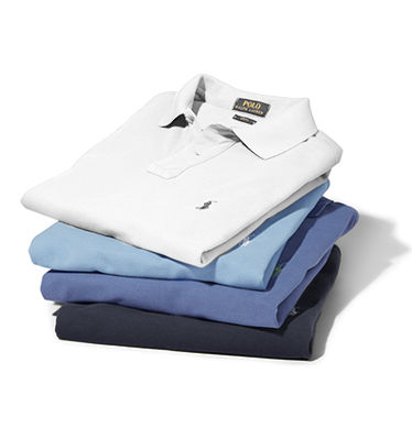 Stack of folded white & blue Polo shirts