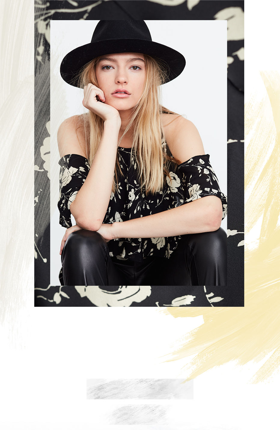 Woman models black brimmed hat & floral-print cutout-shoulder top