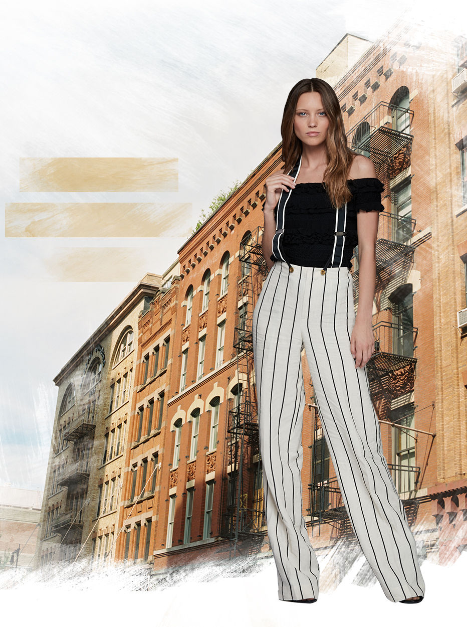 Model in high-waisted striped pants worn with suspenders