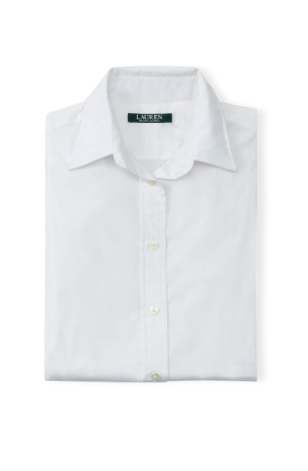 Folded white button-down shirt