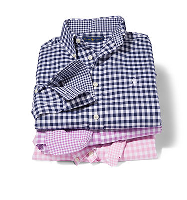 Stack of folded navy, purple & pink gingham checked shirts