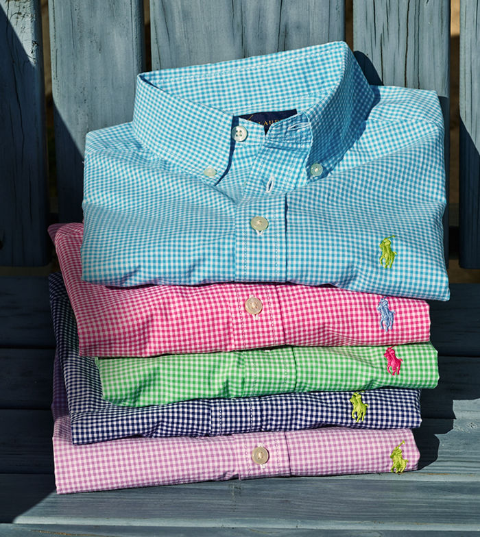 Stack of folded gingham button-downs in bright spring hues