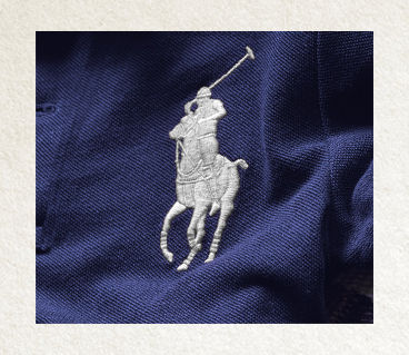 Close-up image of white embroidered signature pony