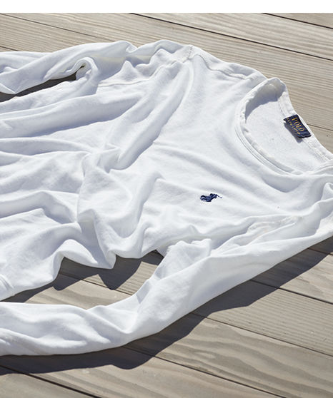 White sweatshirt with embroidered navy Polo Pony at chest