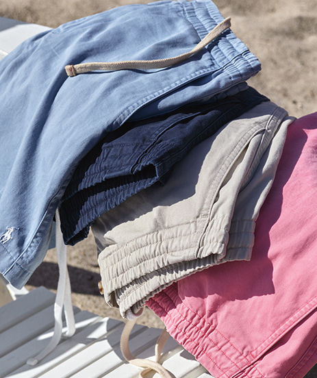 Faded prepster shorts in light blue, navy, grey, and pink.